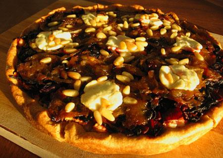 Chard, Beet Green, Caramelized Onion, Ricotta, Goat Cheese, & Pine Nut Pizza