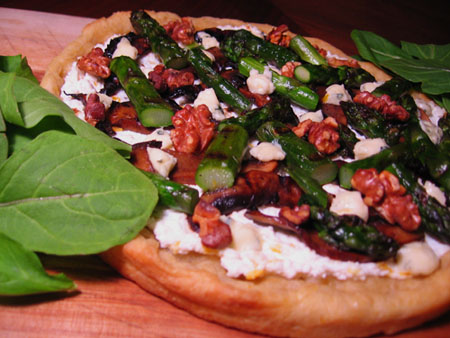 Pizza with lemon ricotta, grilled portabellas, grilled asparagus, toasted walnuts, blue cheese, and arugula