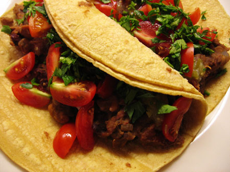 Tacos with cinnamon refried beans and cherry tomatoes
