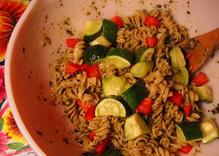 Gluten-free spirals with vegan pesto, zucchini, and tomato