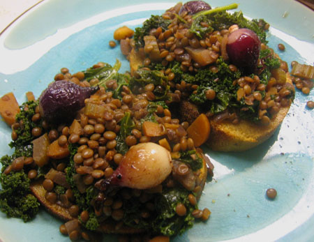 ... lentils over gluten-free quinoa toast with Tuscan kale and pearl