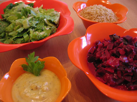 Beet, beet greens, and carrot curry with salad, quinoa, and Indian-spiced yogurt