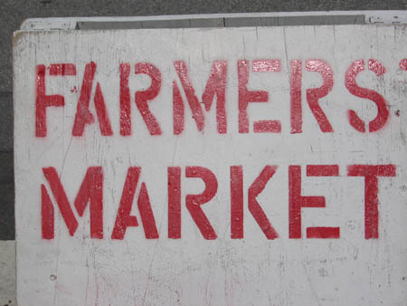"Stenciled ""Farmer's Market"" sign"